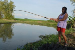 Woman fishing | Bosque Fishing Project in the Philippines