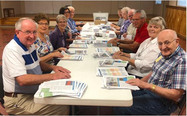 Volunteers preparing a mailing
