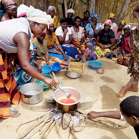 Women in Malawi empowered; making tomato sauce for the lean times