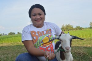 Tess with her goat in the Philippines