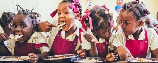 Haitian school girls eating lunch