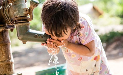 Child in Philippines drinking water