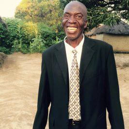 Outreach Zambia community parter Benjamin smiles in triumph