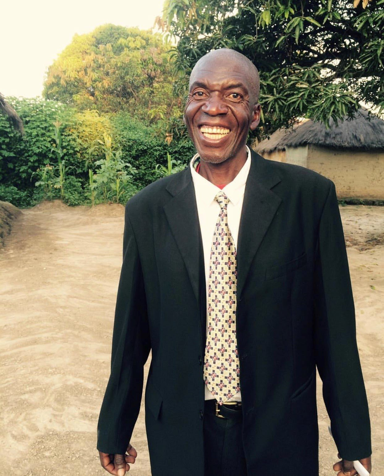 Outreach Zambia community parter Benjamin smiles in triumph