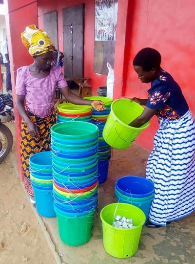 Community members from Malawi prepare basins for use in handwashing stations 1