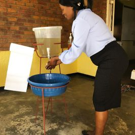 Outreach Zambia office staff installed their own handwashing station outside their offices.