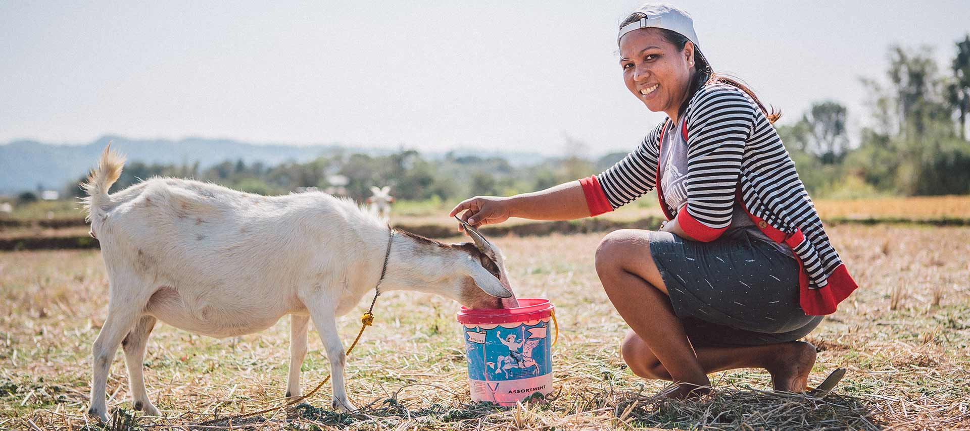 Woman with Goat in the Philippines