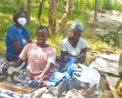 Clementina and some of her fellow tailors in Zambia laugh while sewing face-masks