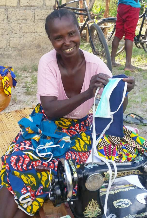 Emeldah, another Outreach Zambia superstar, shows off the latest handiwork produced by her team.