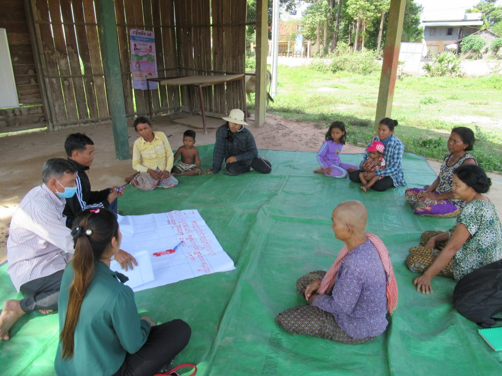 Even more community members in Leap Village, Cambodia meet with a member of Outreach Cambodia's field team