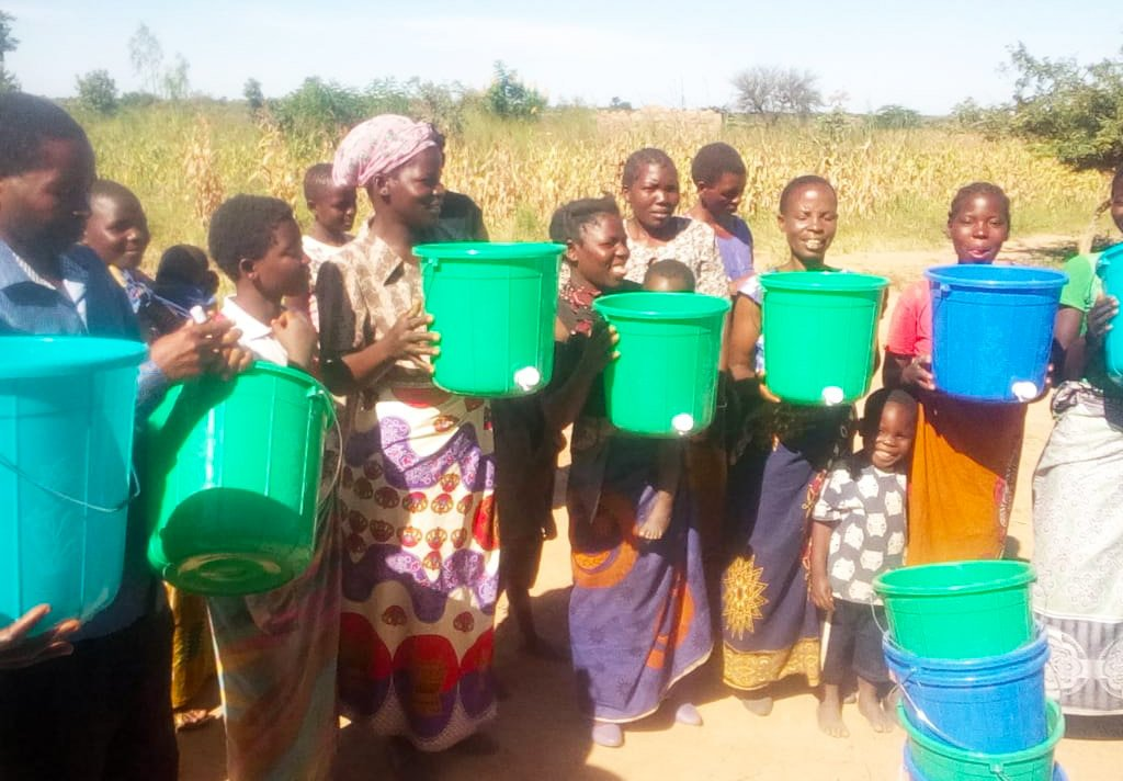 Community Members in Malawi Show off their new hand-washing stations