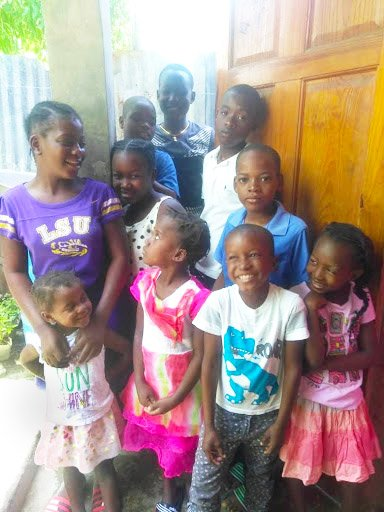 Children from Outreach's Haiti Schools Feeding Program show off their smiles for the camera