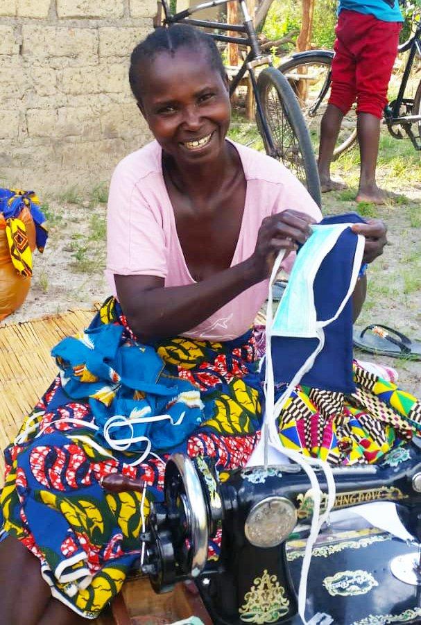 Malawian woman showing mask | COVID-19 Project Update