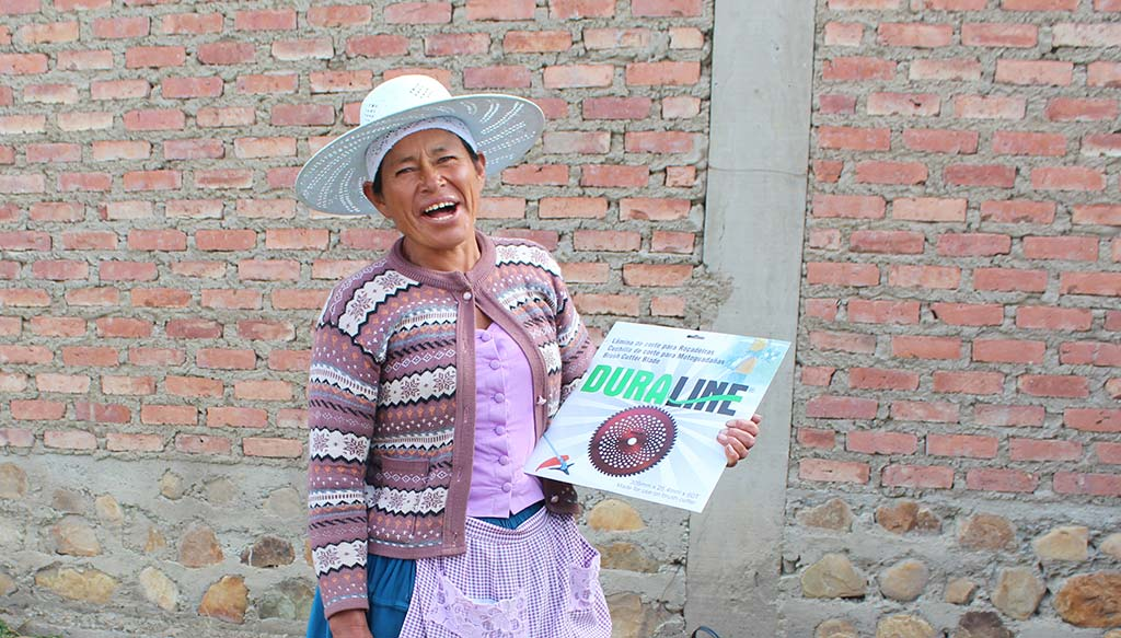 Woman holding plans for Bolivian irrigation project