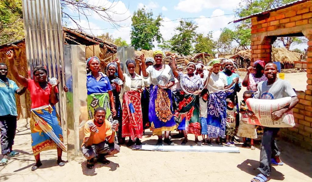 Malawi Community Members Celebrate Completion of Goat Houses