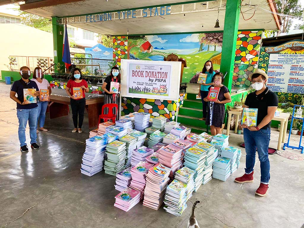 Philippines community members celebrating book project delivery