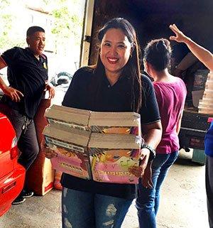 Philippine community member carries new books