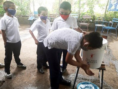 Students using the sanitation station at their local school in Nicaragua
