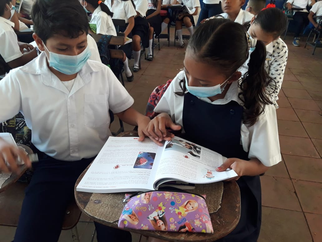 Students using their books in class - local school in Nicaragua