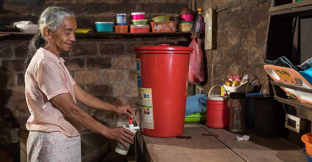 Woman Using Ceramic Water Filters in Nicaragua