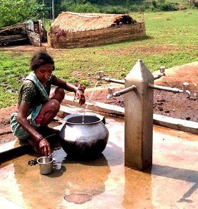 Woman using Nandabad, India Solar Water System Pump
