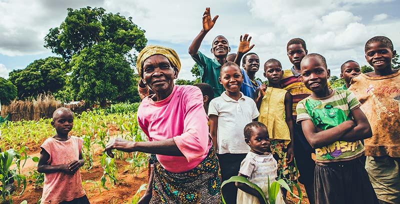 Joyful community members in Malawi