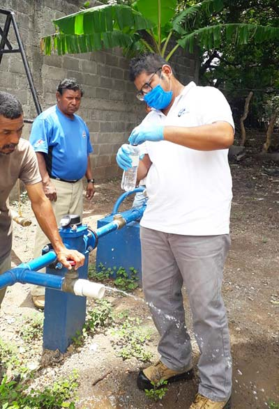 Testing water from water pump in Nicaragua, Outreach International 2020 highlights